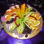 Fruits decorated with feathered pears, celery brushes, curled beets & mini pepper flowers