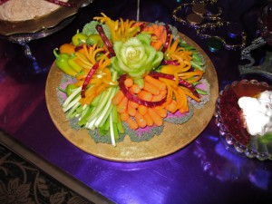 Veggies decorated with a celery rose, curled beets, mini pepper flowers
