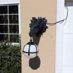 Dragon sconce flanking garage