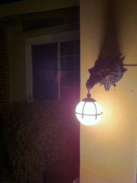 Dragon sconce at night