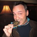 Glen chomps his Edible Medal