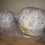 Couple layers of papier-mache on pumpkins
