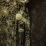 Jeweled spider hanging on tassel