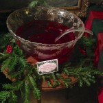 Cranberry punch decorated with fresh greens and berries