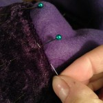 Hidden hem stitch to attach the purple velvet trim