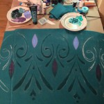 Painting the skirt with traditional rosemaling techniques