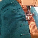 Adding the top bronze ribbon trim before fully assembling the bodice