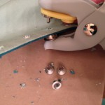 Using the eyelet tool to set the silver grommets