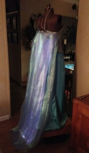 Double fabric over the lower-density fiber-optic shawl = better but not as wide as the cape