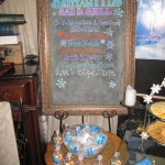 Menu chalkboard with bottles of Melted Snow
