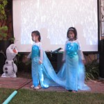 Two Elsas Dancing in the Falling Snow