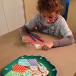 Adam decorating Kite Cookies