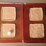 Pizza crusts before and after par-baking to set the shape