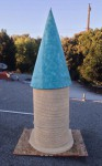 Spire tucked onto the tower in the nested foam base