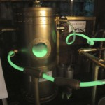 Glowing ectoplasm circulating from the distillers into the Ectoplasm Engine to power the Spirit Materializer