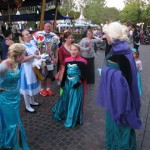 3 Elsas discussing costume details