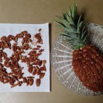Adding the best pecans in an overlapping pineapple pattern