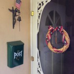 Front Door Wreath and Doorbell Dragon Holding a Flag