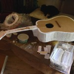 Papier-mâché guitar in process