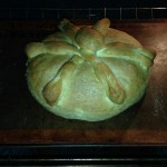 decorative Pan de Muertos loaf assembled and baked