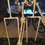 custom PVC skeleton stands being painted bone color to blend in