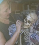 painting the bright white animatronic skulls to match the skeleton patina