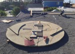 Repairing and reinforcing the 8-foot moon screen up on the roof