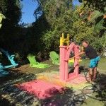 Yours truly spraying colorful Mexican-inspired basecoats on plain white foam gravestones...