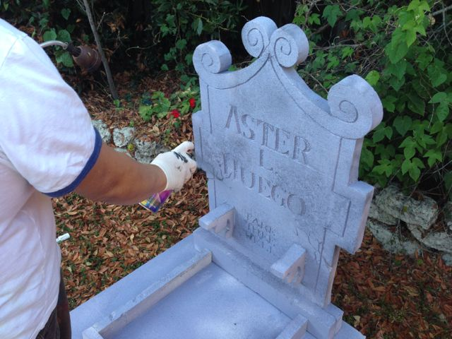 Scary Jerry aging gravestones with spray paint and dripping water after basecoats were quickly dry in the hot sunshine...