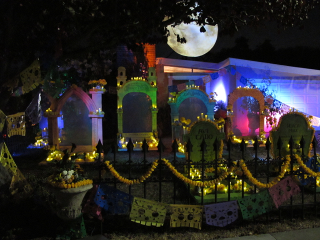 Harvest moon above the decorated graveyard