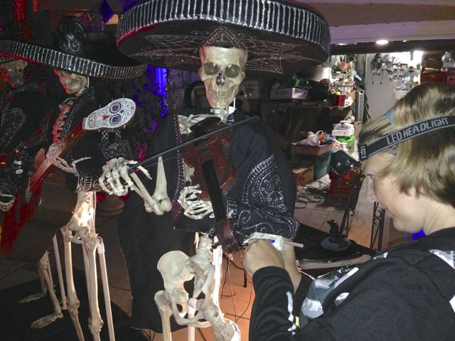 Glue gun hems dressing the Mariachis de Muerte at 5am Friday morning!