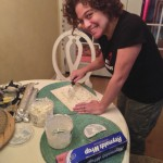 Shannon filling the vertebrae rolls while I cooked our breakfast