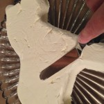 Smoothing the cream cheese before painting
