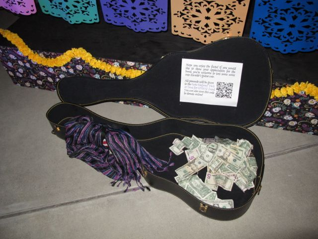 Grand total of $219.84 of donations to UNICEF in Ricardo's guitar case