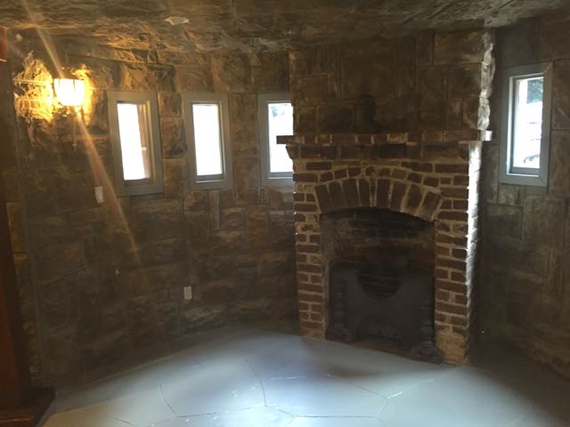 The walls and even ceiling were exterior flagstone veneer, but oddly-plain concrete floor.