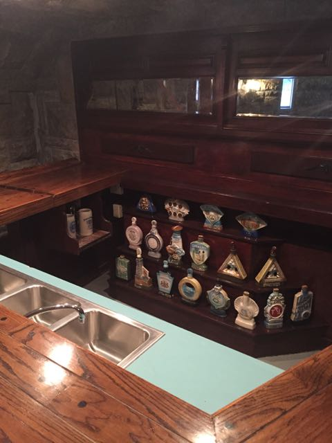 ...but if you looked over the gorgeous wood bar, you saw an ancient aqua formica counter...heh! Cool bottle collection, though.
