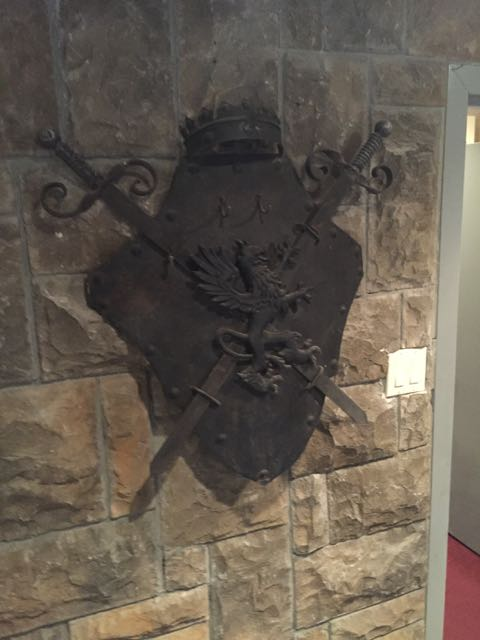 Very cool metal coat of arms sculpture.