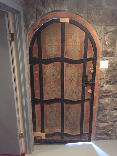 "Scandinavian-inspired painted door. All the ""iron"" is carved & painted wood, as you can see from repairs yet to be painted. But why not paint the light-switches too? ;)"