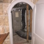 We found the utility closet in the basement! I know those curved doorjambs are not easy.
