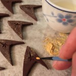 Painting gold luster dust onto the Classic Trek Chevron Chocolates