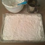 Homemade marshmallows spread and dusted