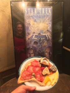Lt. Peterson's dinner: Starfleetza grilled pizza, Reboot Rollup, Federation Fruit Salad, Chevron Cheese, Commbadge Chocolate, and S'more Trek!