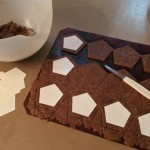 Cutting the perfect size homemade vegan graham crackers for the Chocolate Frog marshmallow cards