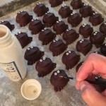 Painting eyes on the custom-molded Chocolate Frogs