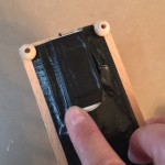 Hiding the battery pack under a duct tape hinge