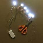 Mini battery pack LED lights on copper wire