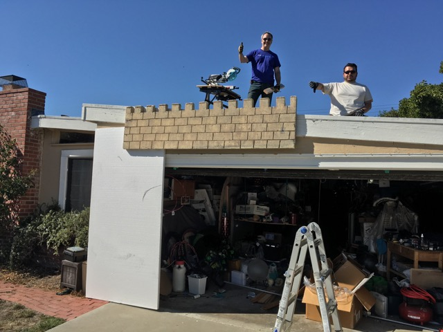 Ghoulish Glen & Scary Jerry helping hang the ramparts from the roof side