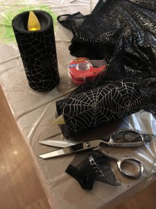 "Covering pillar candles in sheer web fabric ""costumes"""