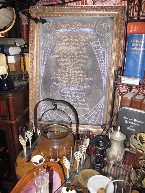 Menu chalkboard with glass cauldron of Bobbing Apple Punch